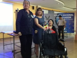 CCI presents a manual wheelchair to the police officers