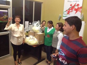 President of Patronato of Milagro, Staff receive from Causas para el Cambio nutritional supplements